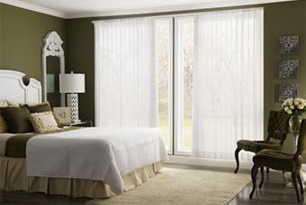Sheer indoor curtains on sliding glass door