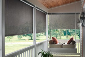Outdoor solar shades installed by Benjamin Draperies