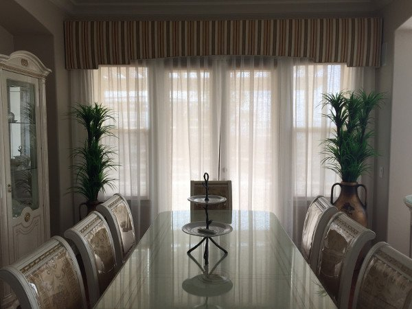 Custom drapes in a dining room