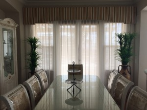 Custom Drapes shading a Dining Room