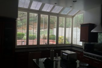 Motorized Silhouette Shades on a large angled kitchen window