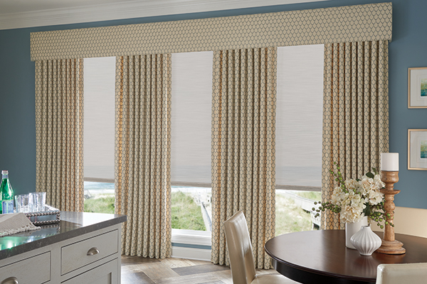 Lightly colored drapes with a cross hatch pattern alongside a very large window