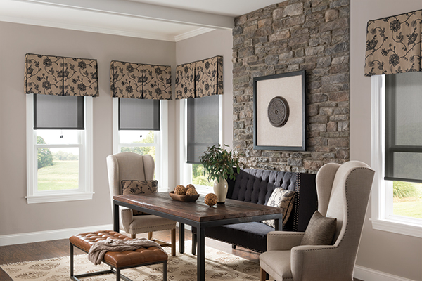 Drapes with a floral design above the windows of a living room