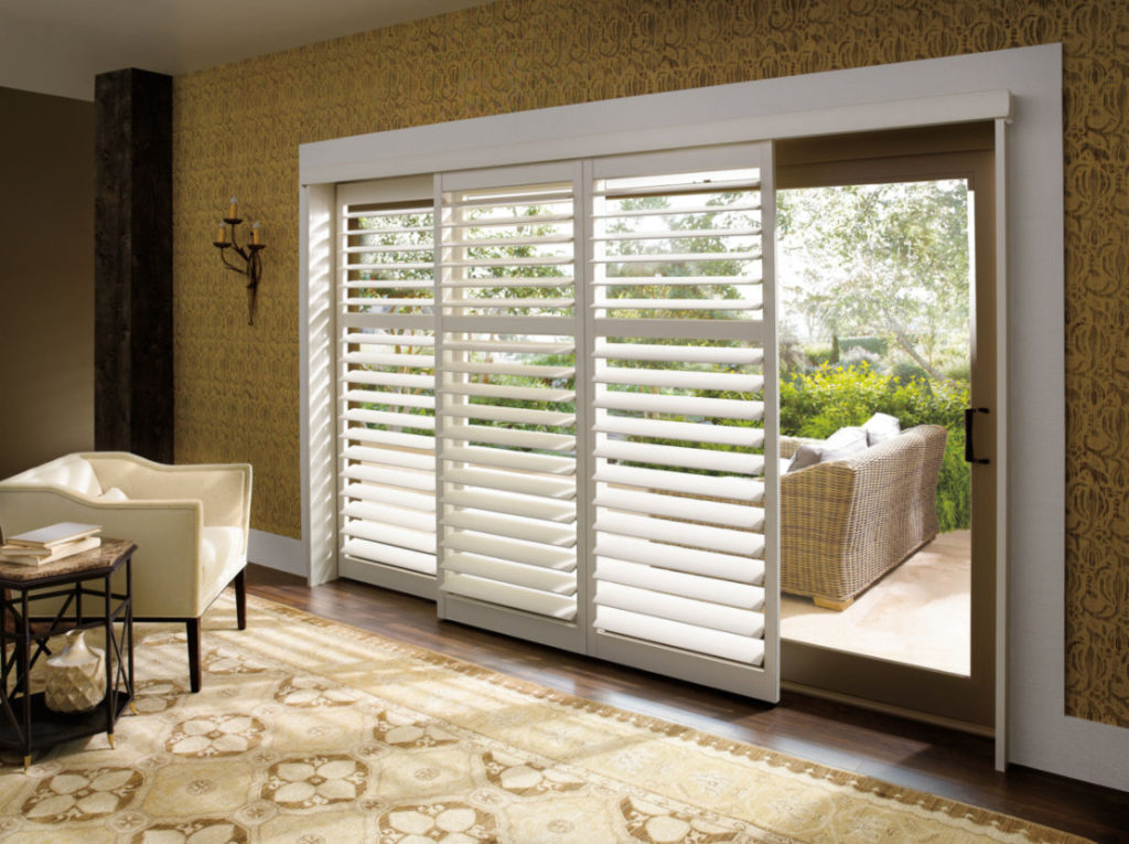 Polysatin shutters on a large glass door
