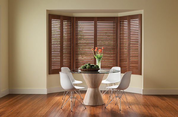Wood shutters in a dining room