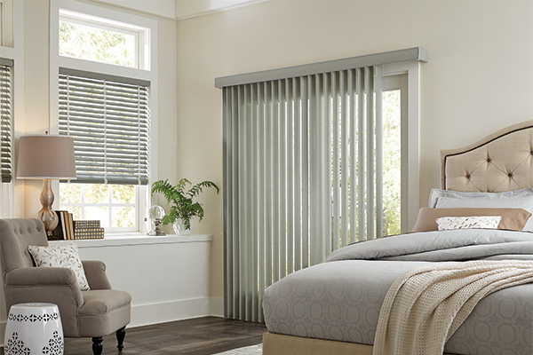 Vertical Blinds covering a glass door in a bedroom