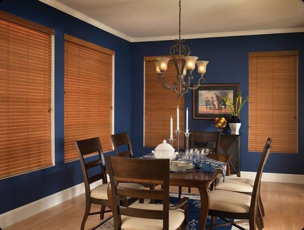 Wood Blinds used to cover windows in a dining room