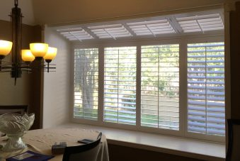 Wood Shutters covering a bay window